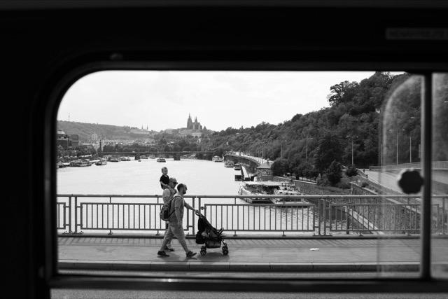 Pedestrian on Prague bridge