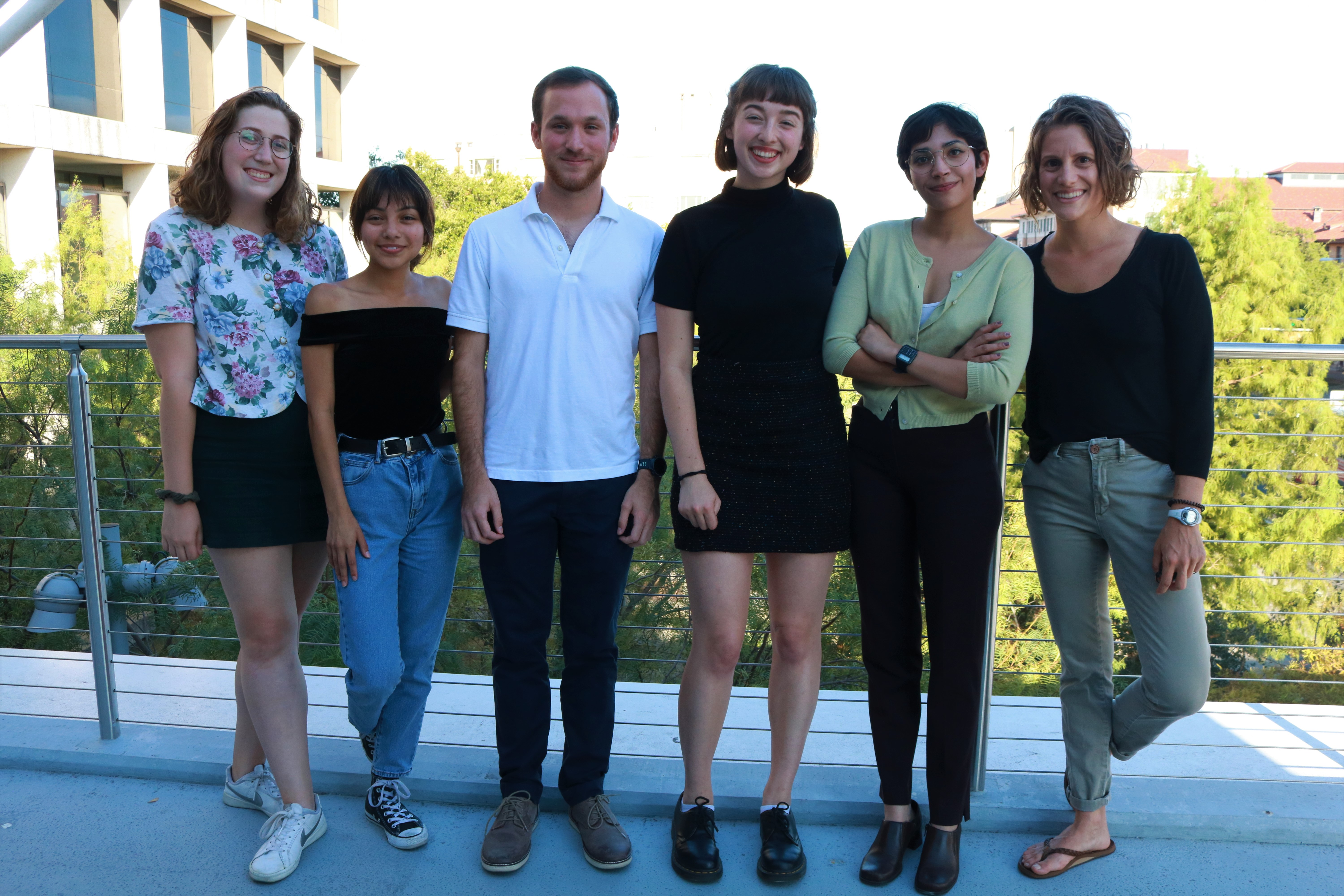Audio directors Sara, Anissa, Cesar, Haley, Tinu and Saba pose for a picture on the Moody College sky bridge